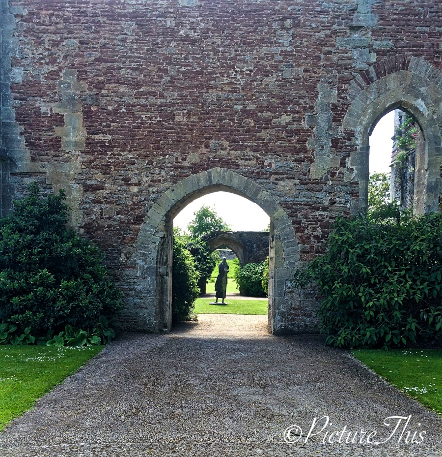 Stone archway leading to gardens